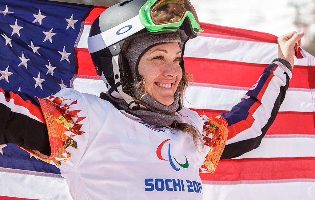Amy Purdy holds an American flag over her shoulders