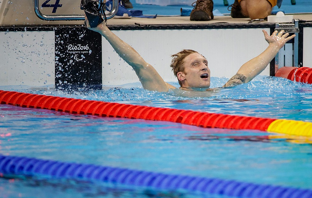 Arms out, Brad Snyder exults after winning gold.