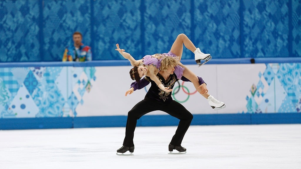Ice dancer Meryl Davis rests across the back of partner Charlie White's shoulders
