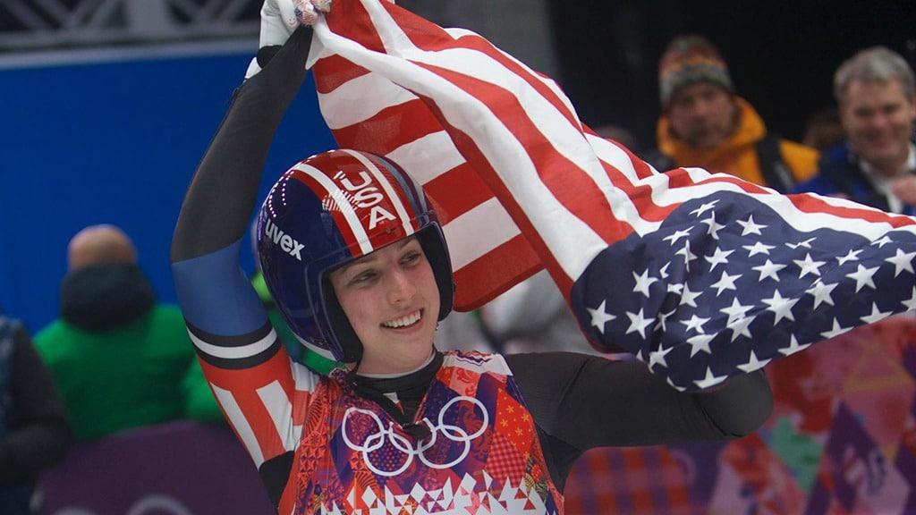 Erin Hamlin holds up American flag