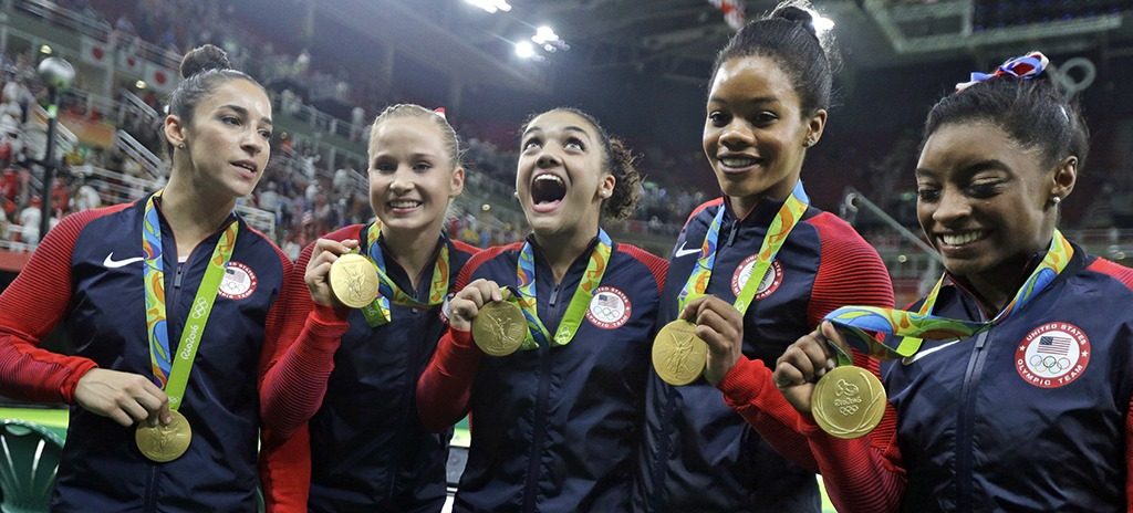 The Final FIve proudly display their gold medals.