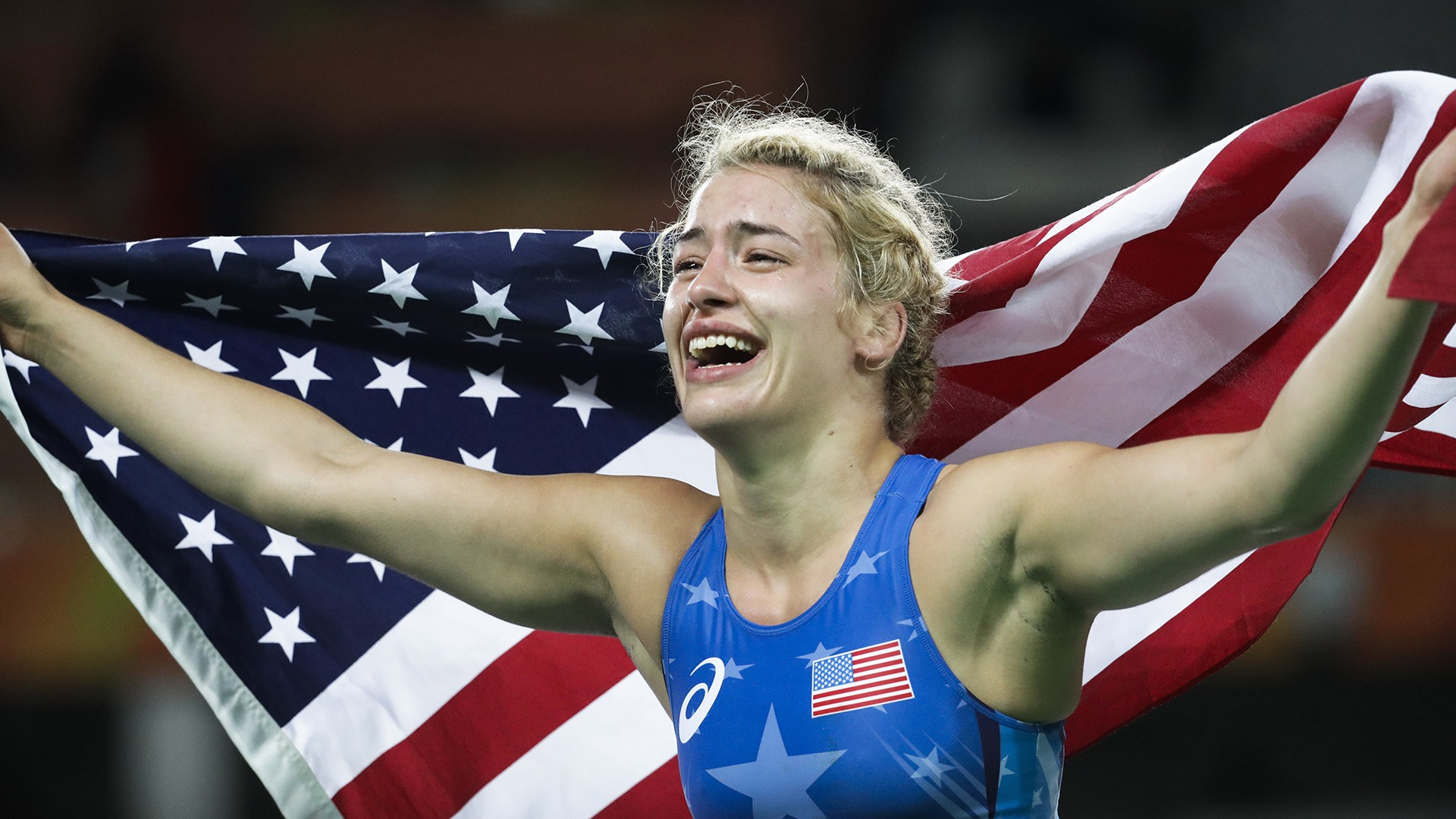Helen Maroulis is crying as she holds as American flag