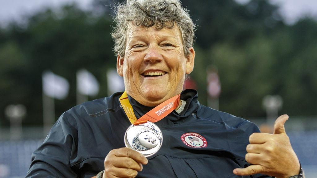Angela Madsen proudly displays her medal