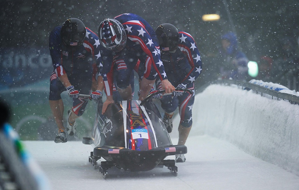 Team USA pushes hard as the start of the bobsled run