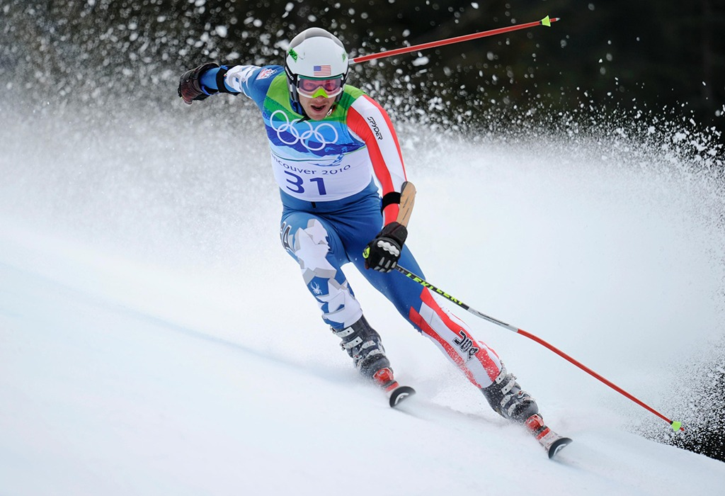 Skier Bode Miller keeps his balance as he speeds down the mountain