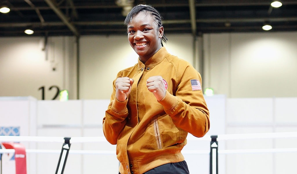 Claressa Shields has her fists cocked as she poses for a photo