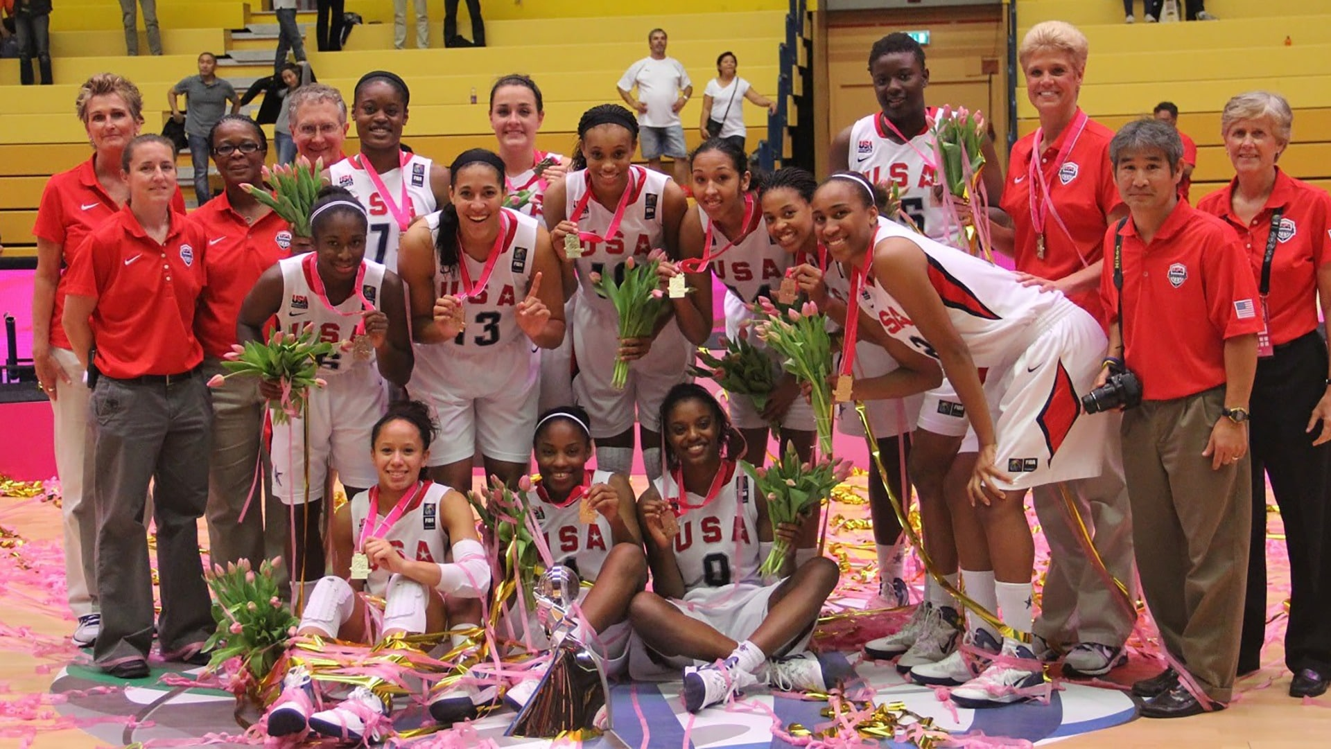 Jill Rankin Schneider poses with her team at the victorious 2012 under-17 world championships.