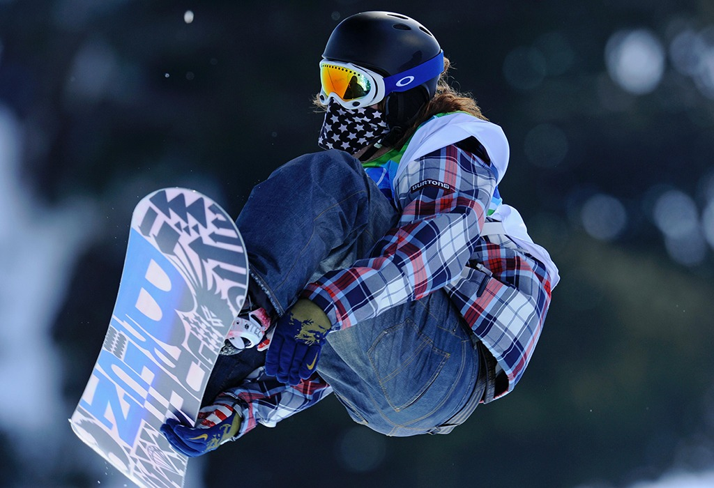 Shaun White is mid-air on a jump
