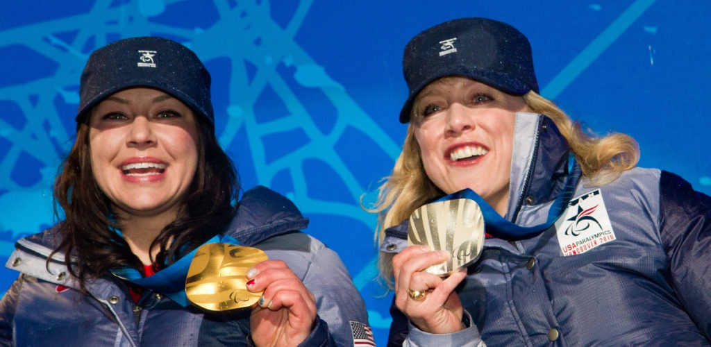 Alana Nichols and Stephani Victor proudly show off their medals