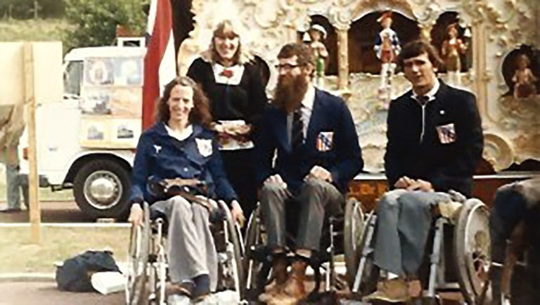 Brad and Sharon Hedrick and basketball player Ed Owen pose with one of their hosts at the Arnhem 1980 Paralympic Games