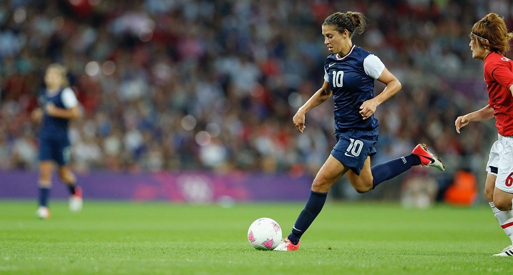 Carli Lloyd is about to strike the ball with her right foot