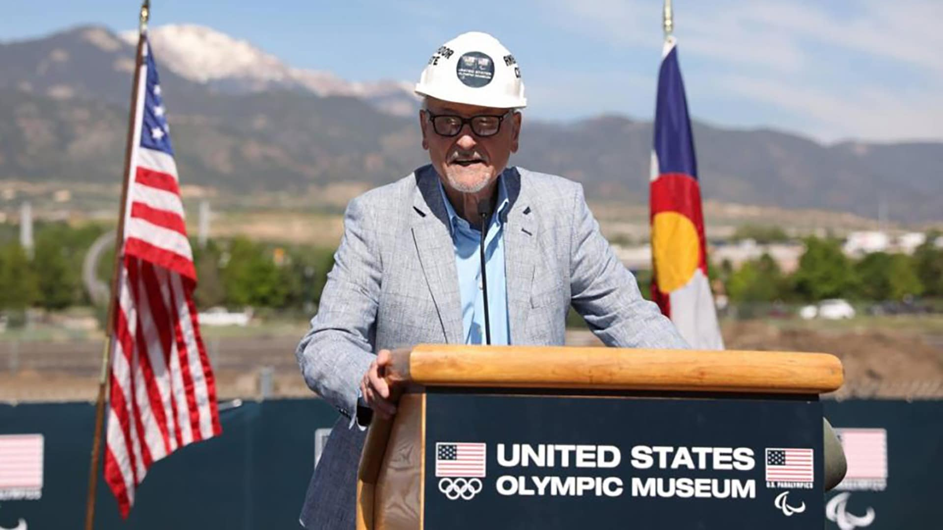 Dick Celeste stands at the podium, wearing a hard hat, and speaks before the official groundbreaking for the Museum