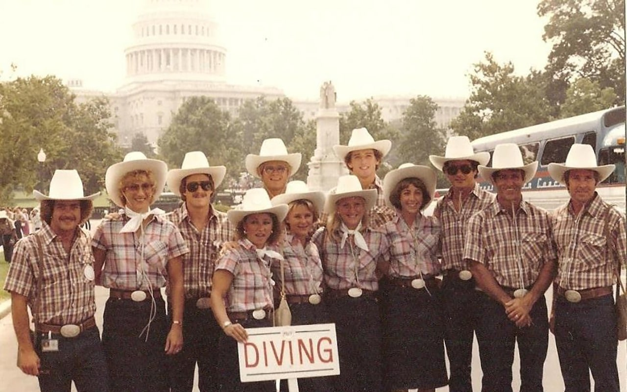 Members of the 1980 U.S. Olympic Diving Team, wearing plaid shirts, jeans and cowboy hats, pose in front of the U.S. Capitol during a visit to Washington