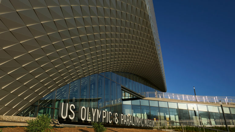 Exterior view of outside of the Museum with U.S. Olympic & Paralympic Museum sign.