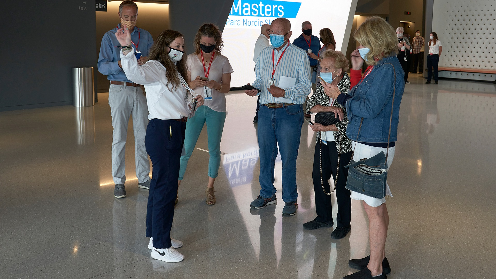A Museum Team Member welcomes guests and points out some features in the lobby