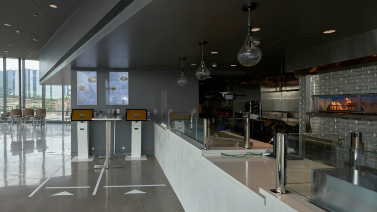 View of the Flame Cafe, with long counter and table seating