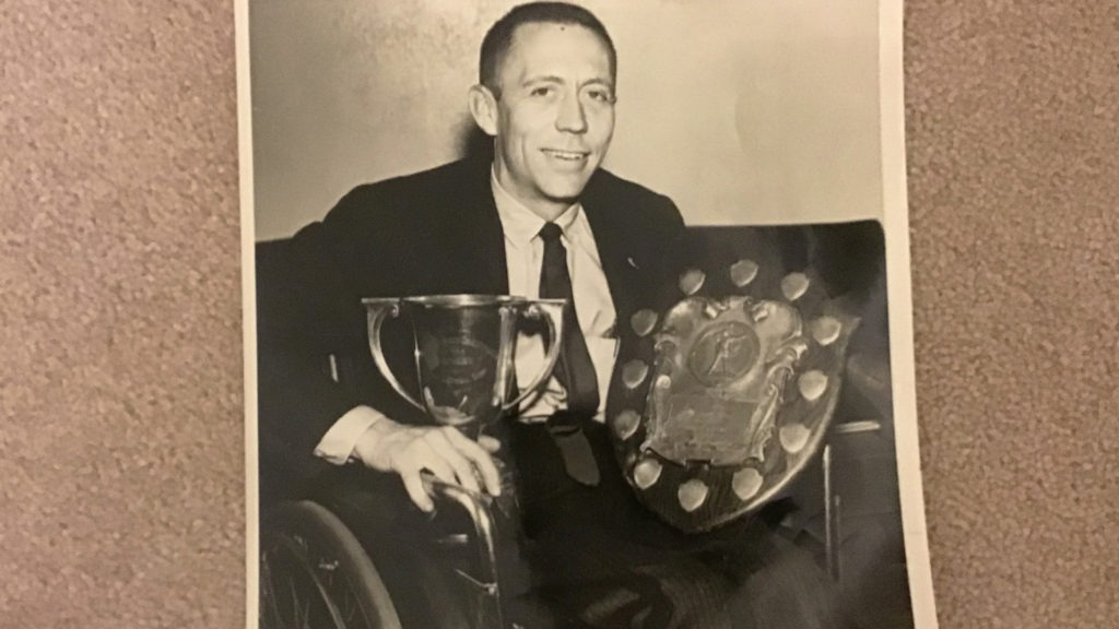 Jack Whitman poses with trophies