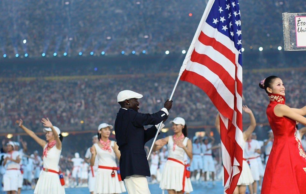 Lopez Lomong carries the U.S. flag into the Opening Ceremony