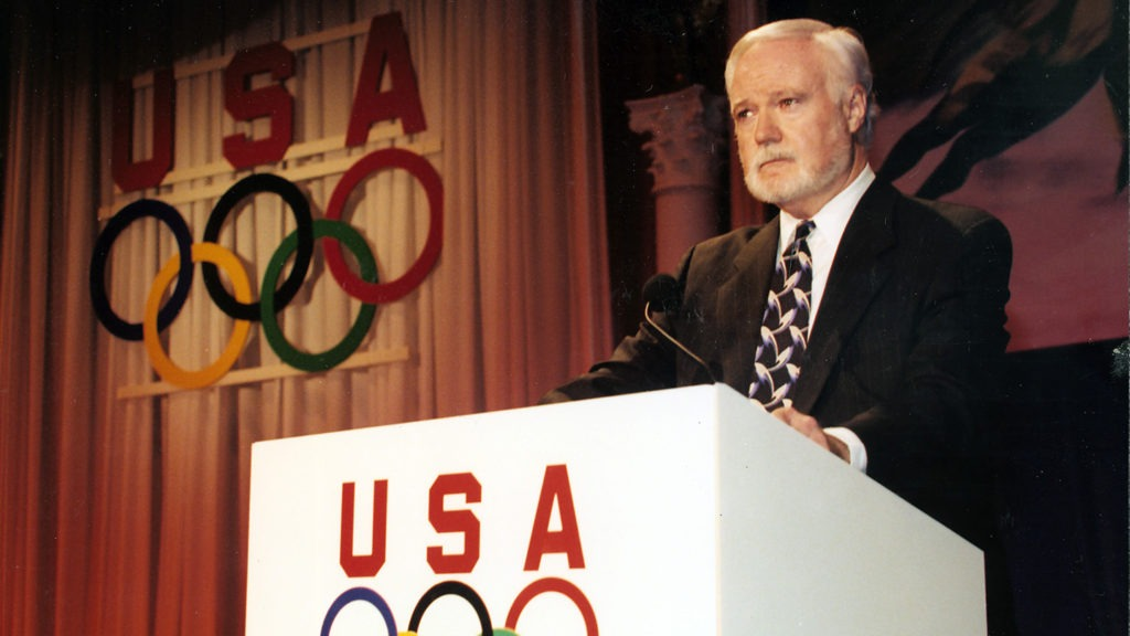Mike Moran presides at a USOC podium