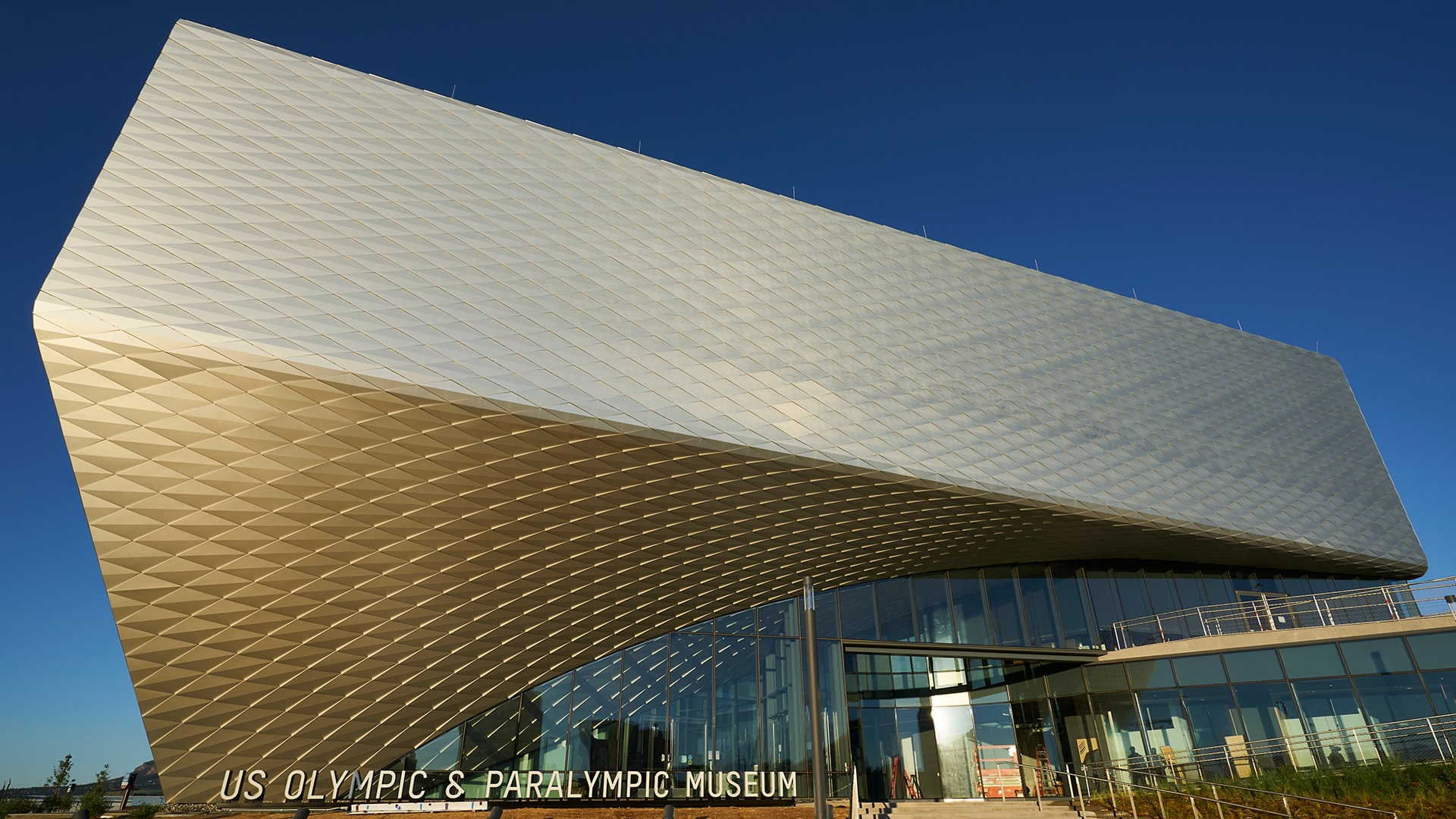 Exterior shot of the Museum with sunlight glistening off the diamond panels