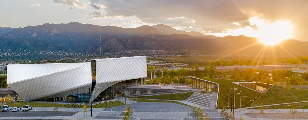Just before setting behind the Rocky Mountains, the sun gleams off the Museum's exterior diamond panels