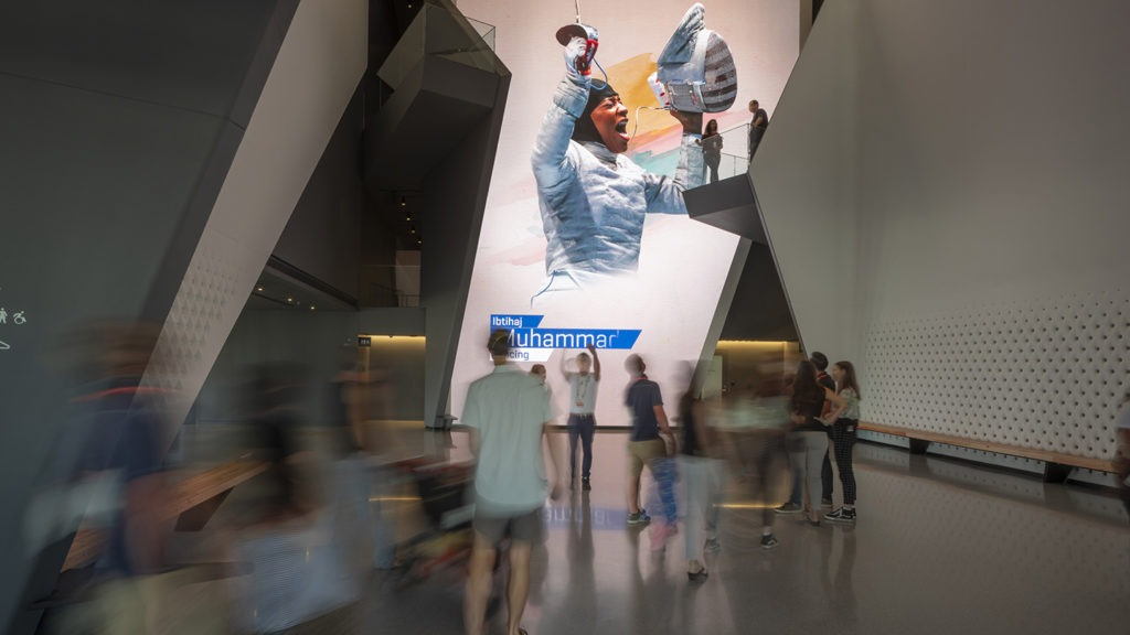 Guests enter the Museum atrium and see the 40-foot LED wall