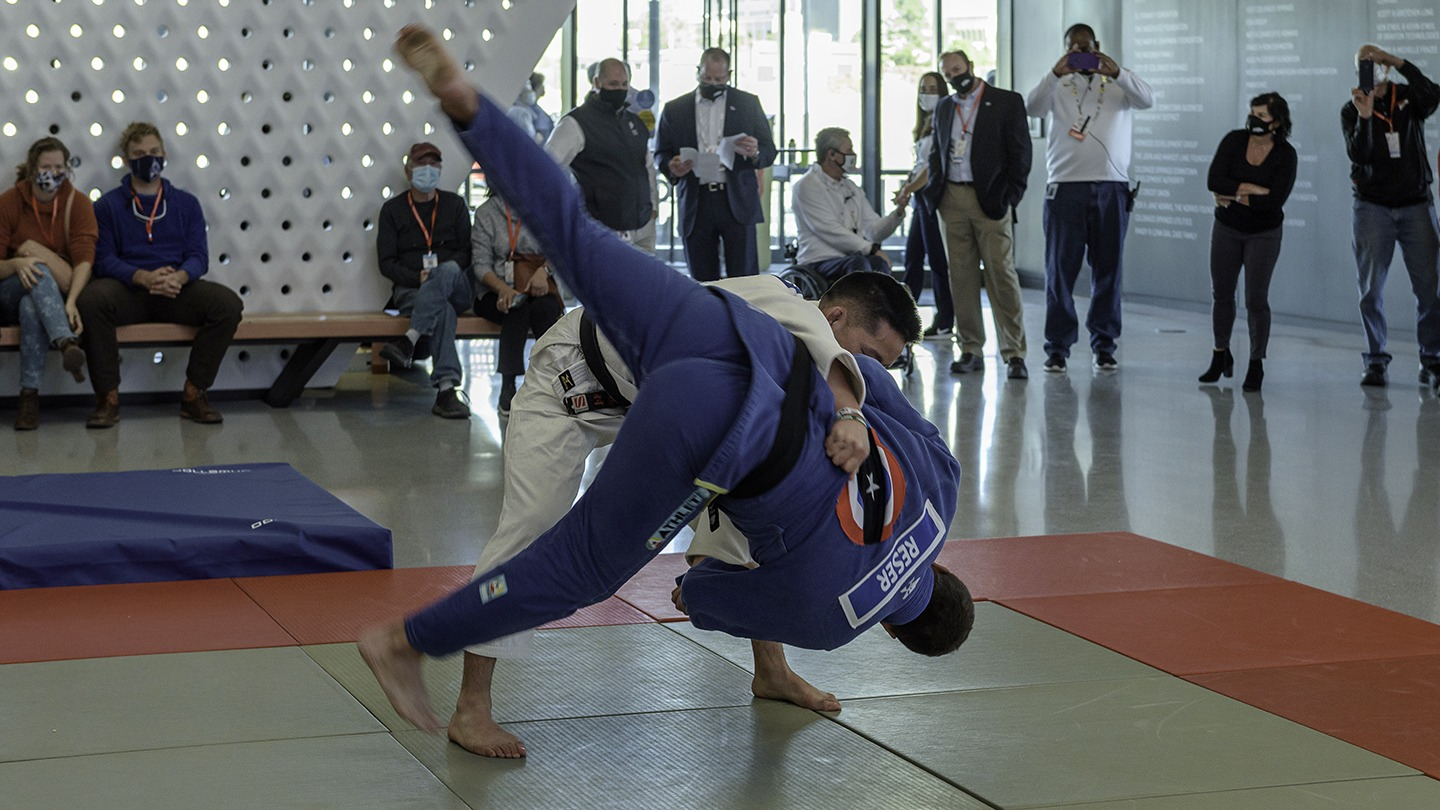 Two judoka show off maneuvers during a demonstration in the Museum atrium.