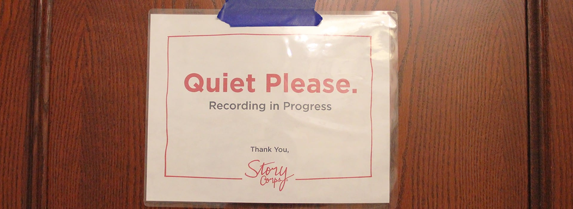 """Sign on a door asks for """"Quiet please"""" while a session is taped"""