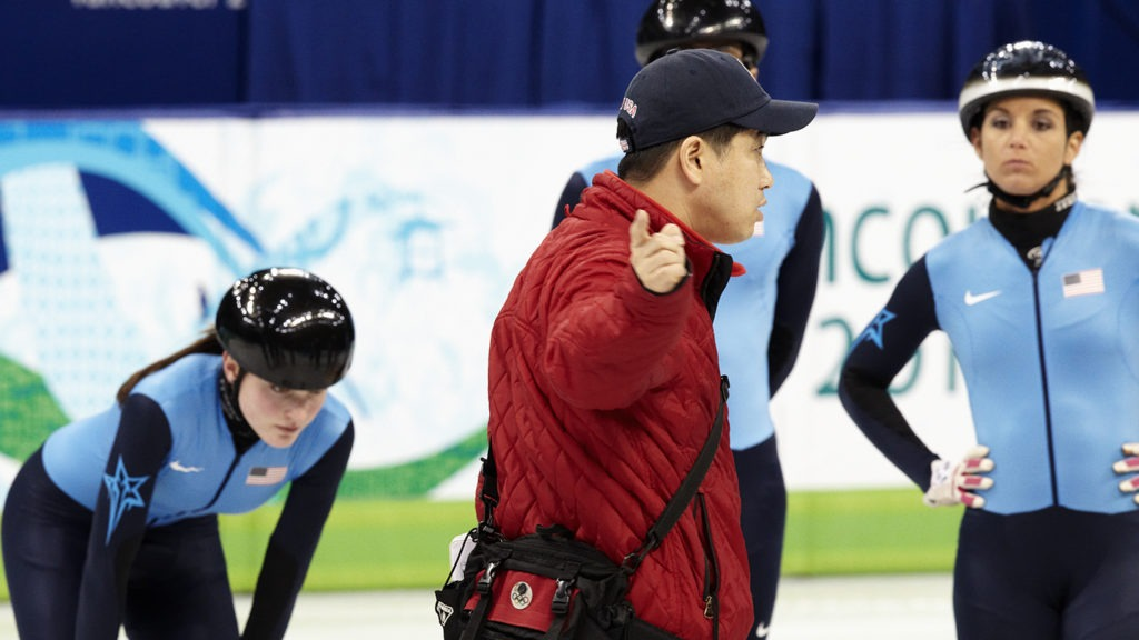 Coach Jae Su Chun works on the ice with Team USA speedskaters at Vancouver 2010.
