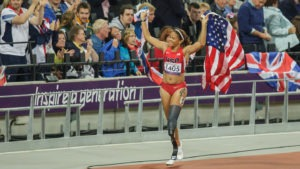 April Holmes drapes an American flag over her shoulders