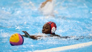 Ashleigh Johnson extends her left arm to grab the ball in the Rio 2016 gold medal game against Italy