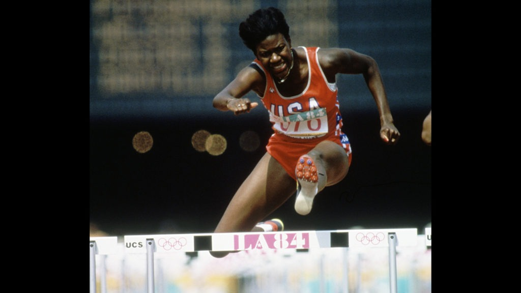 Benita Fitzgerald-Mosley is focused as she clears a hurdle in the 100-meter hurdles at Los Angeles 1984
