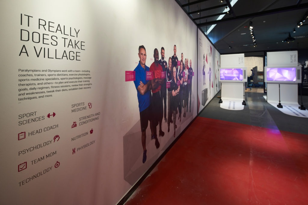 Exhibit wall in the Museum shows how many people are behind an athlete's journey to the Games
