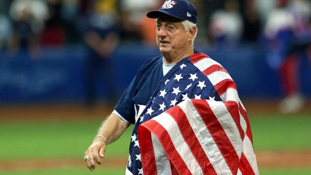 Tommy Lasorda walks with an American flag draped across his left shoulder after guiding the U.S. to Olympic gold at Sydney 2000