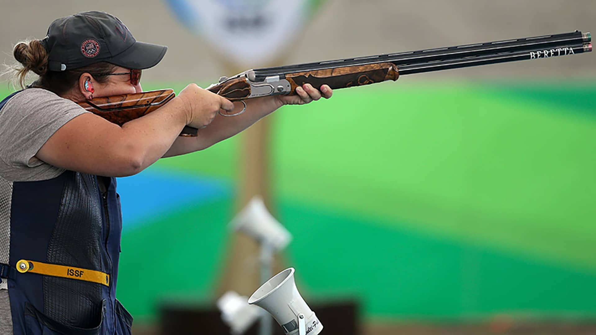 Kim Rhode is focused and takes air at the target