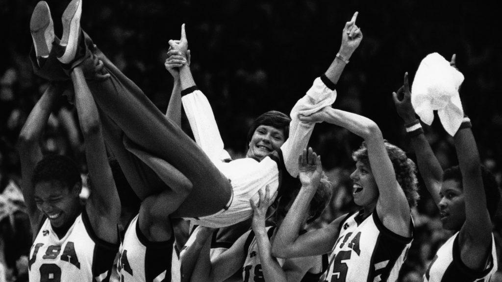 Team USA players hold Coach Pat Summitt aloft to celebrate their victory