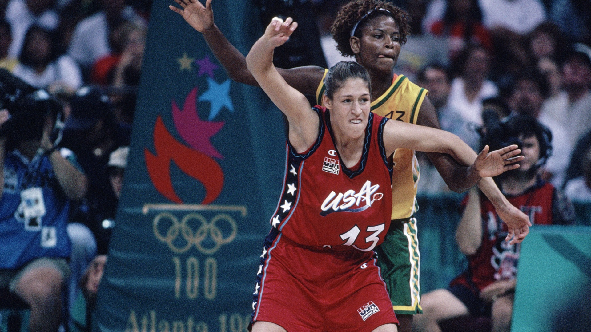 Rebecca Lobo posts up against a defender and waits to receive the ball