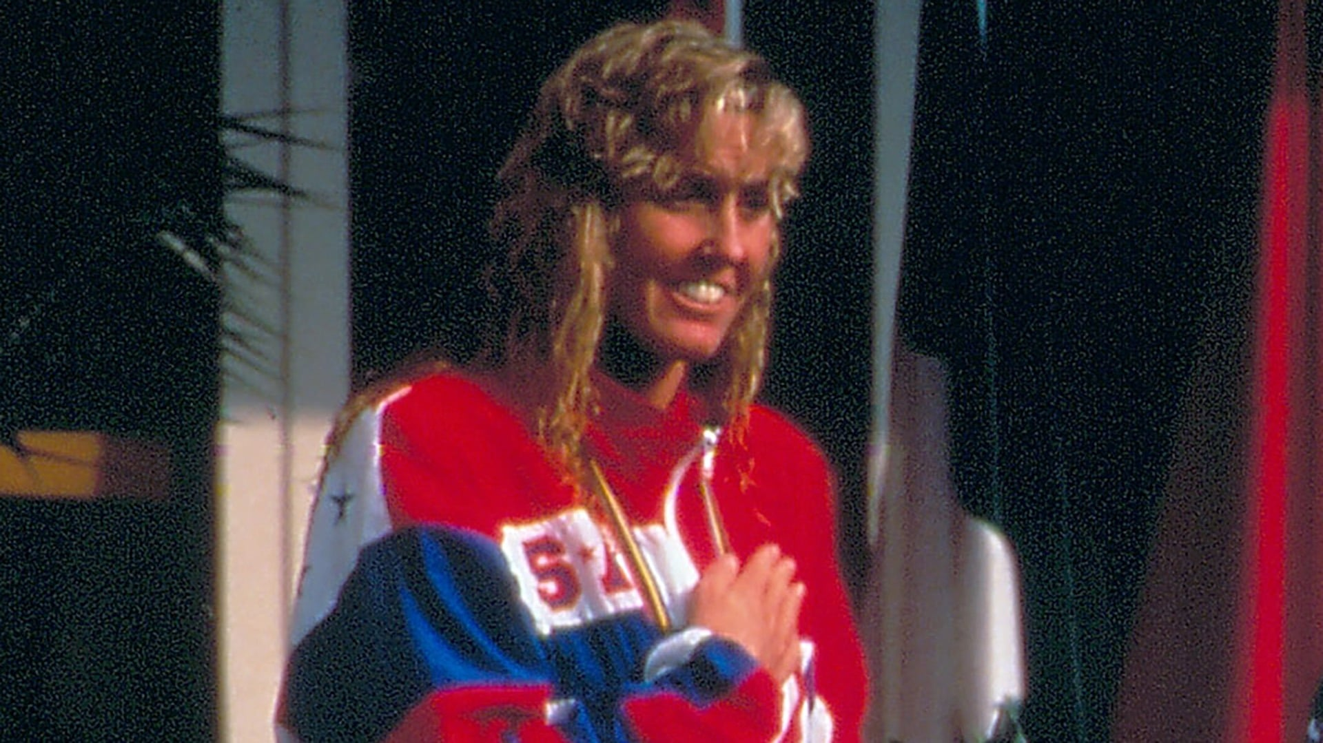 Trischa Zorn has her hand over her heart during the playing of the national anthem at a medal ceremony