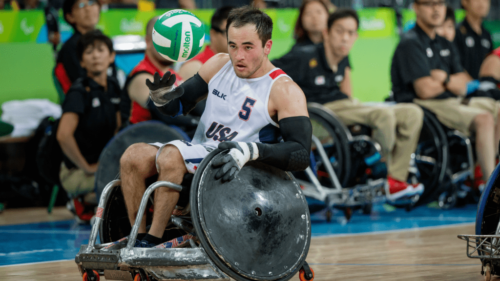 Chuck Aoki handles the ball during a wheelchair rugby match