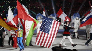 Julie Chu holds an American flag during the Sochi 2014 closing ceremony