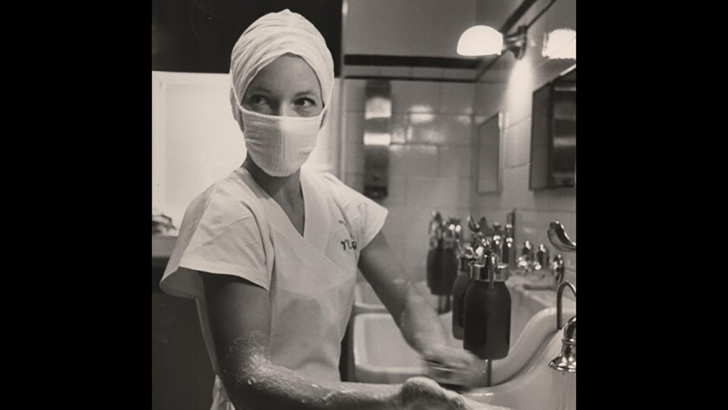 Tenley Albright is dressed in her doctor's scrubs and washing her hands before surgery