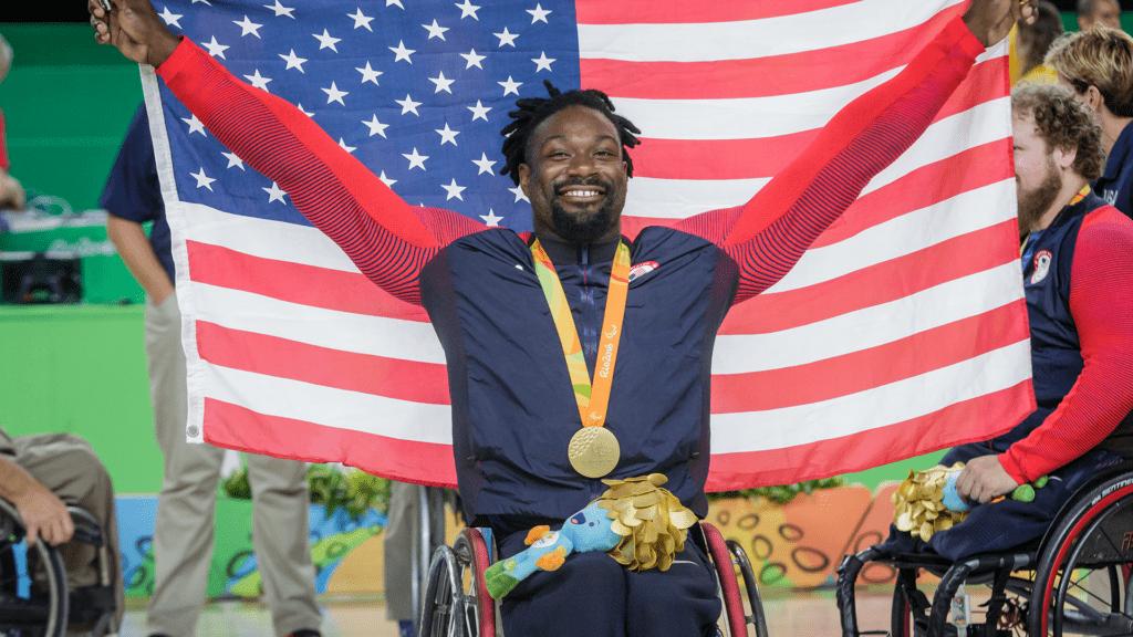 Matt Scott holds an American flag
