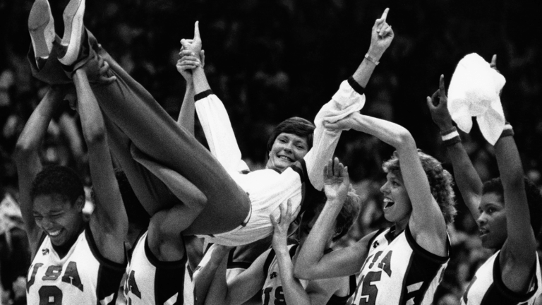 Photo of the Pat Summit being carried by her team