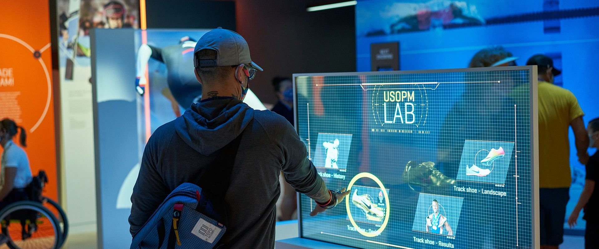 A guest interacts with an exhibit in The Lab